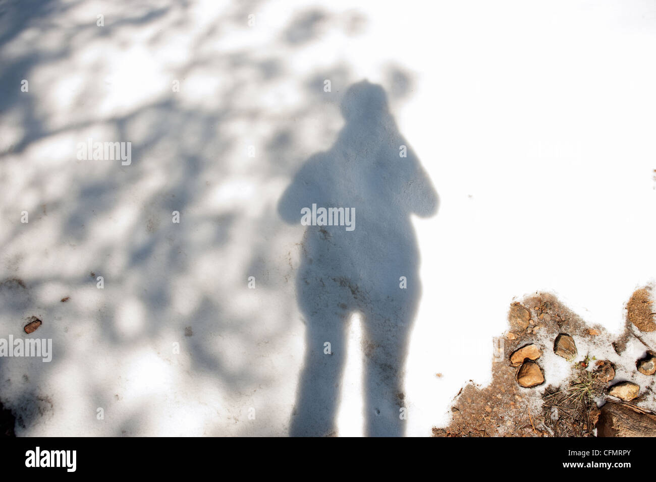 Shadow of photographer on snow. - Stock Image