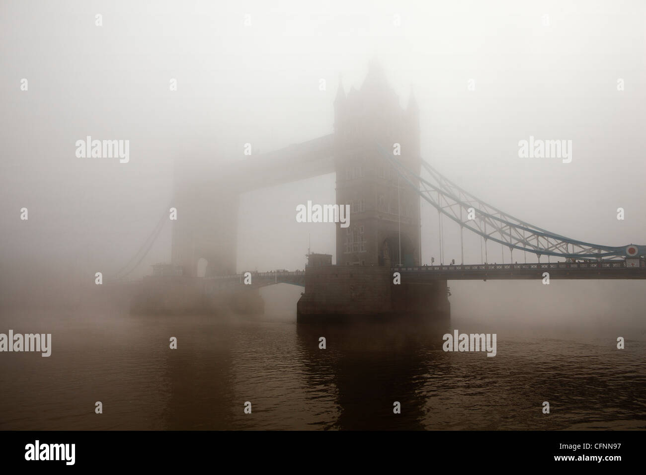 A view of Tower Bridge completely covered in morning mist - Stock Image
