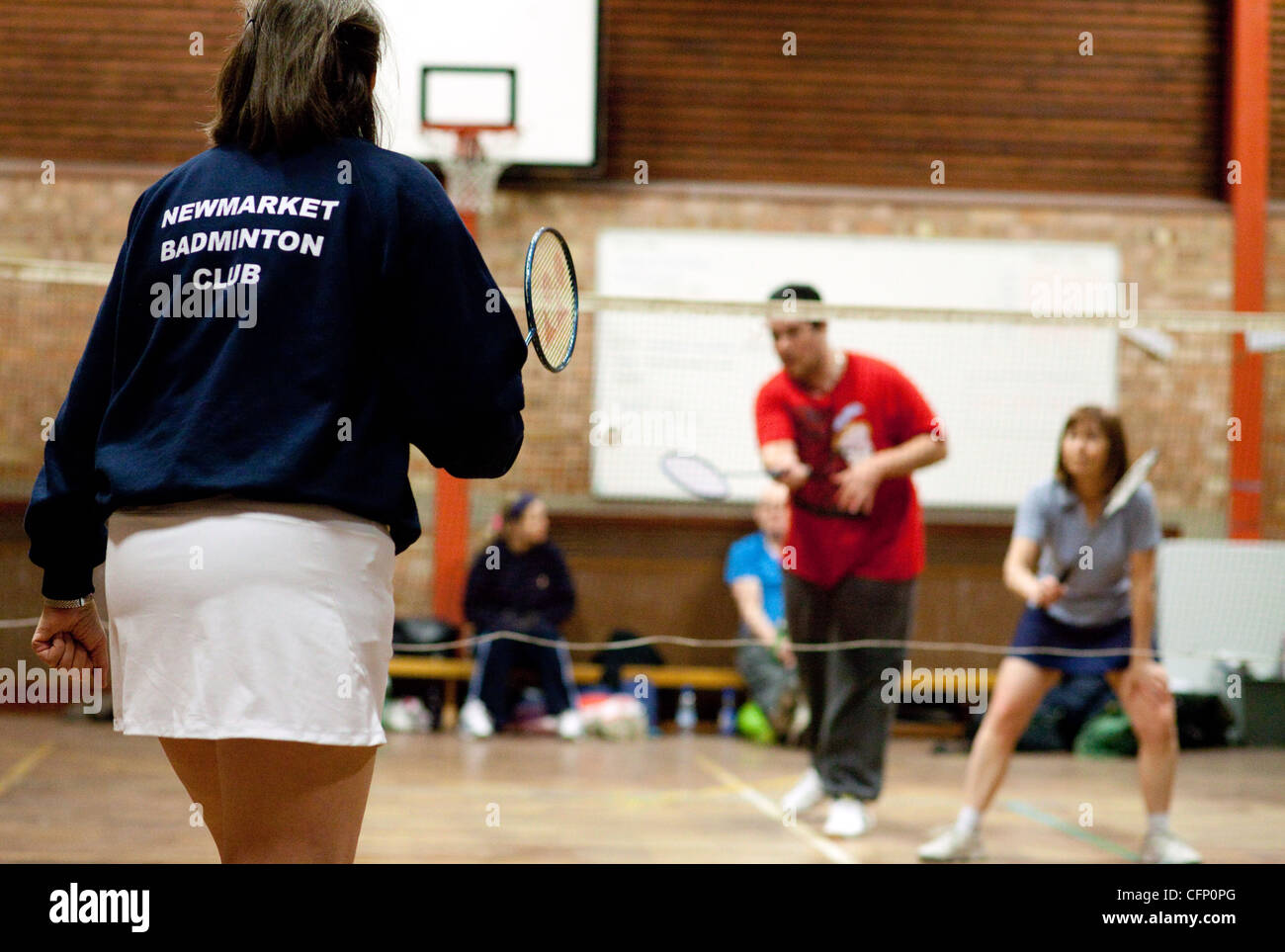 people playing badminton at their local club, Newmarket Suffolk UK - Stock Image