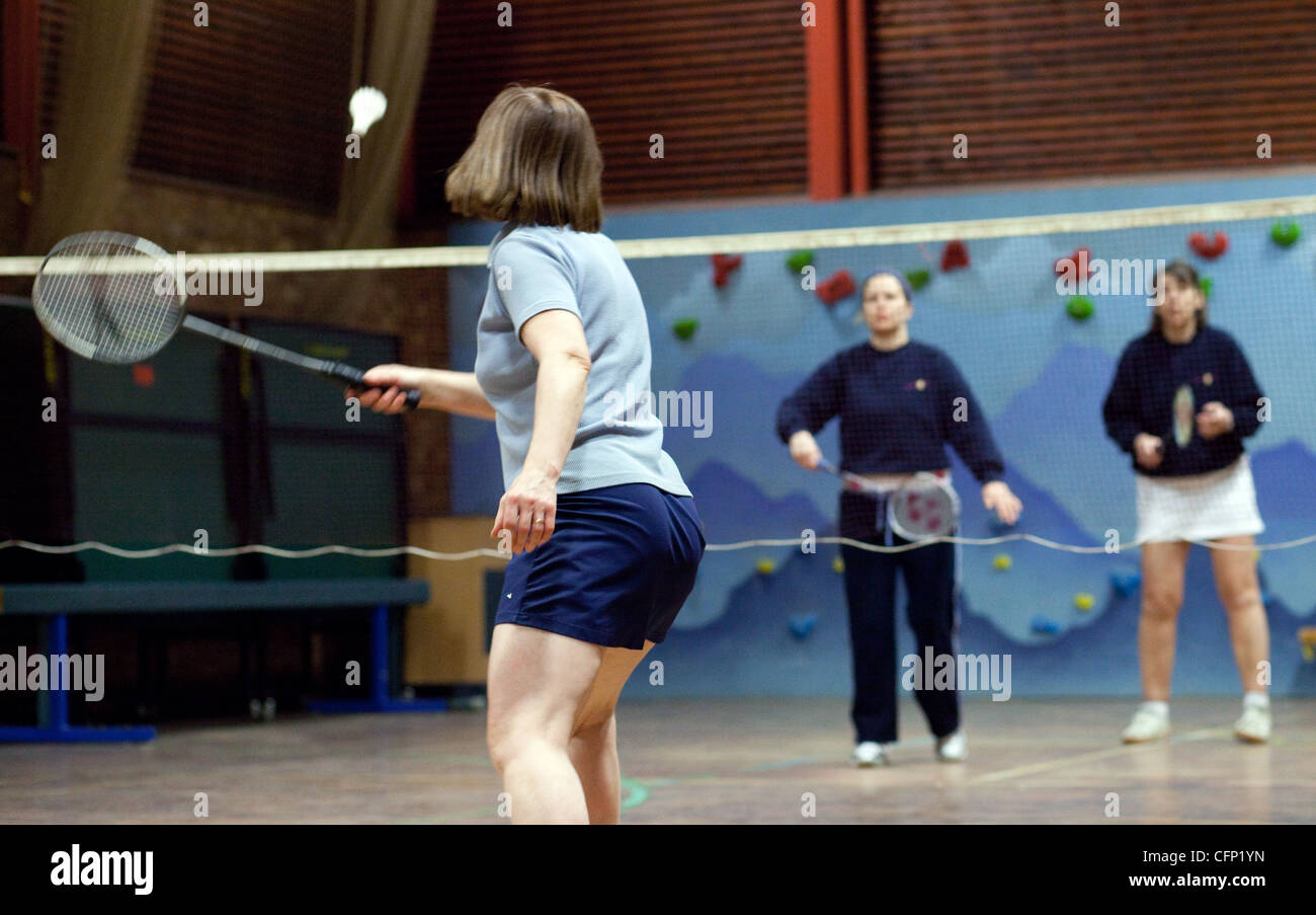 Women playing badminton indoors at their local club, Newmarket Suffolk UK - Stock Image