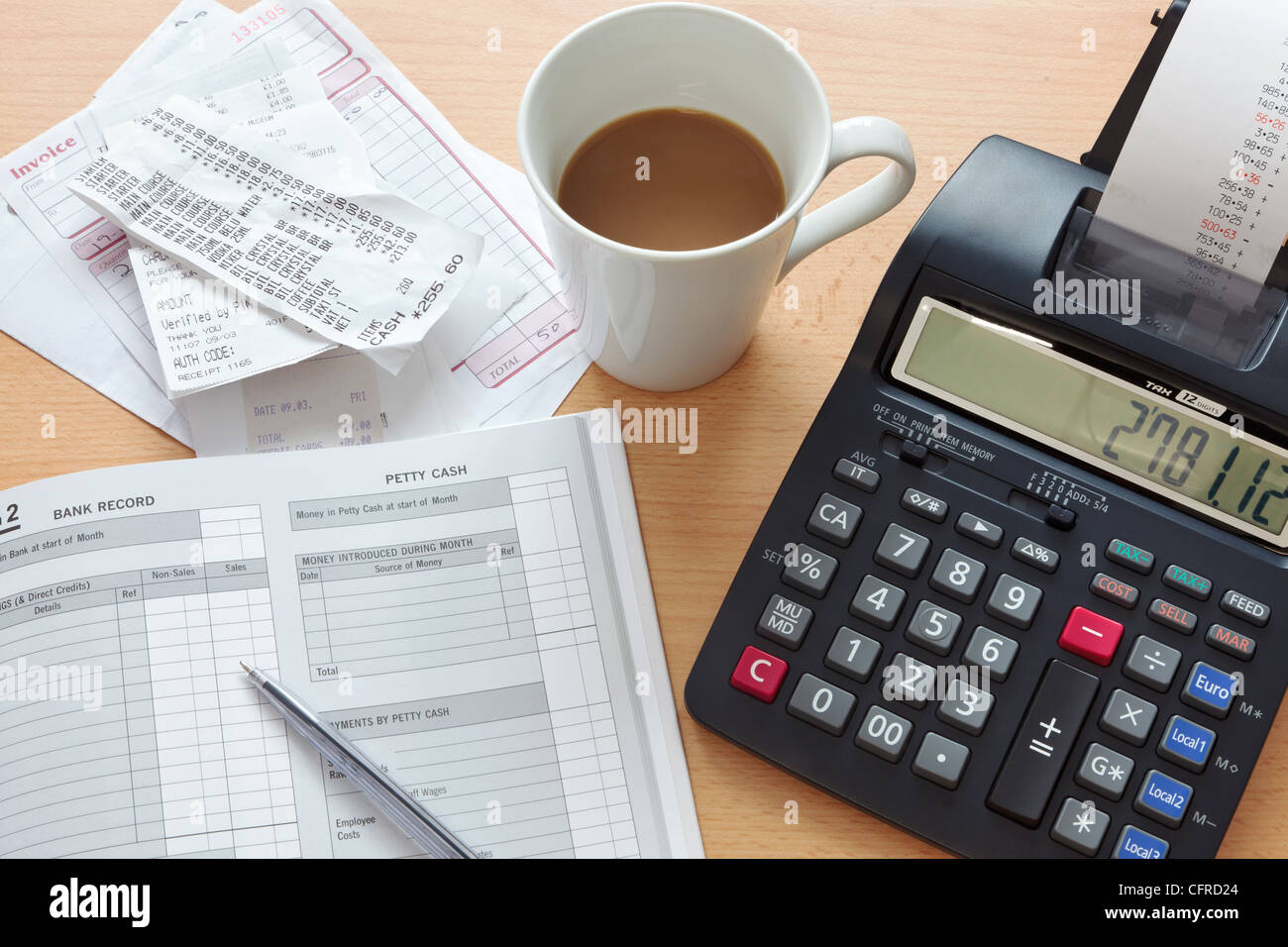 Still life bookkeeping photo of a sales ledger with a pile of receipts, invoices and a print calculator. - Stock Image