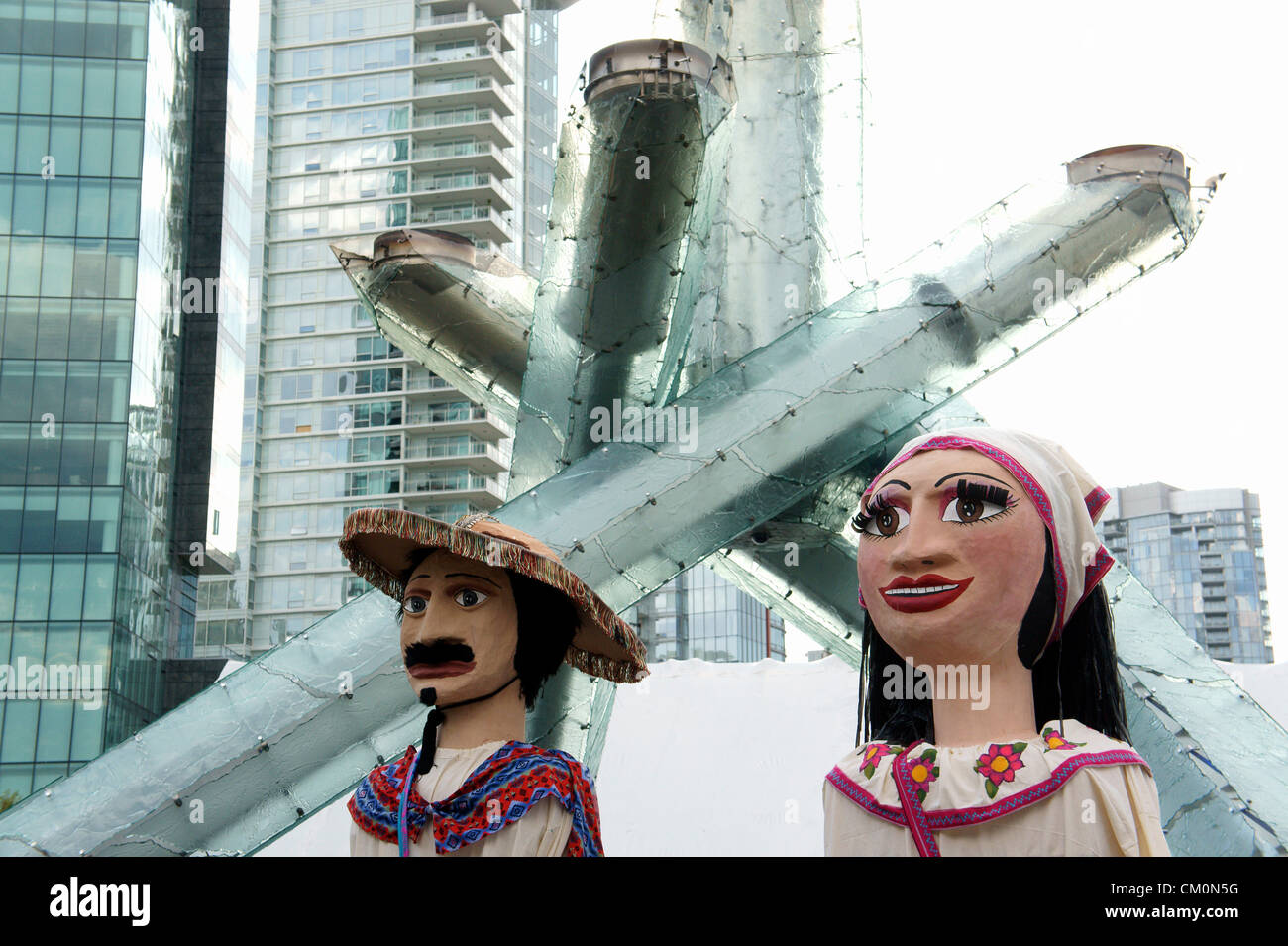 Giant Mexican puppets or mojigangas at  Mexico Fest  celebrations in Vancouver, British Columbia, Canada. - Stock Image