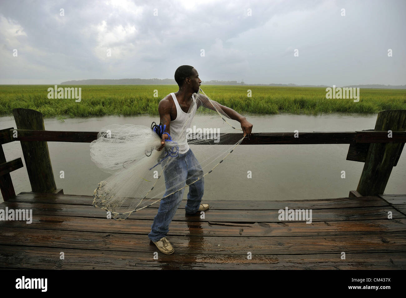 Aug. 23, 2012 - Sapelo Island, Georgia, U.S. -  Casting for bait off a state owned dock, BRANDON DIXON fishes the Stock Photo
