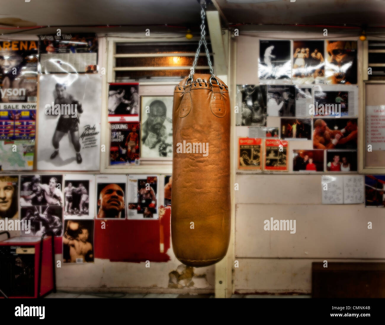 Punchbag in empty London boxing gym. - Stock Image