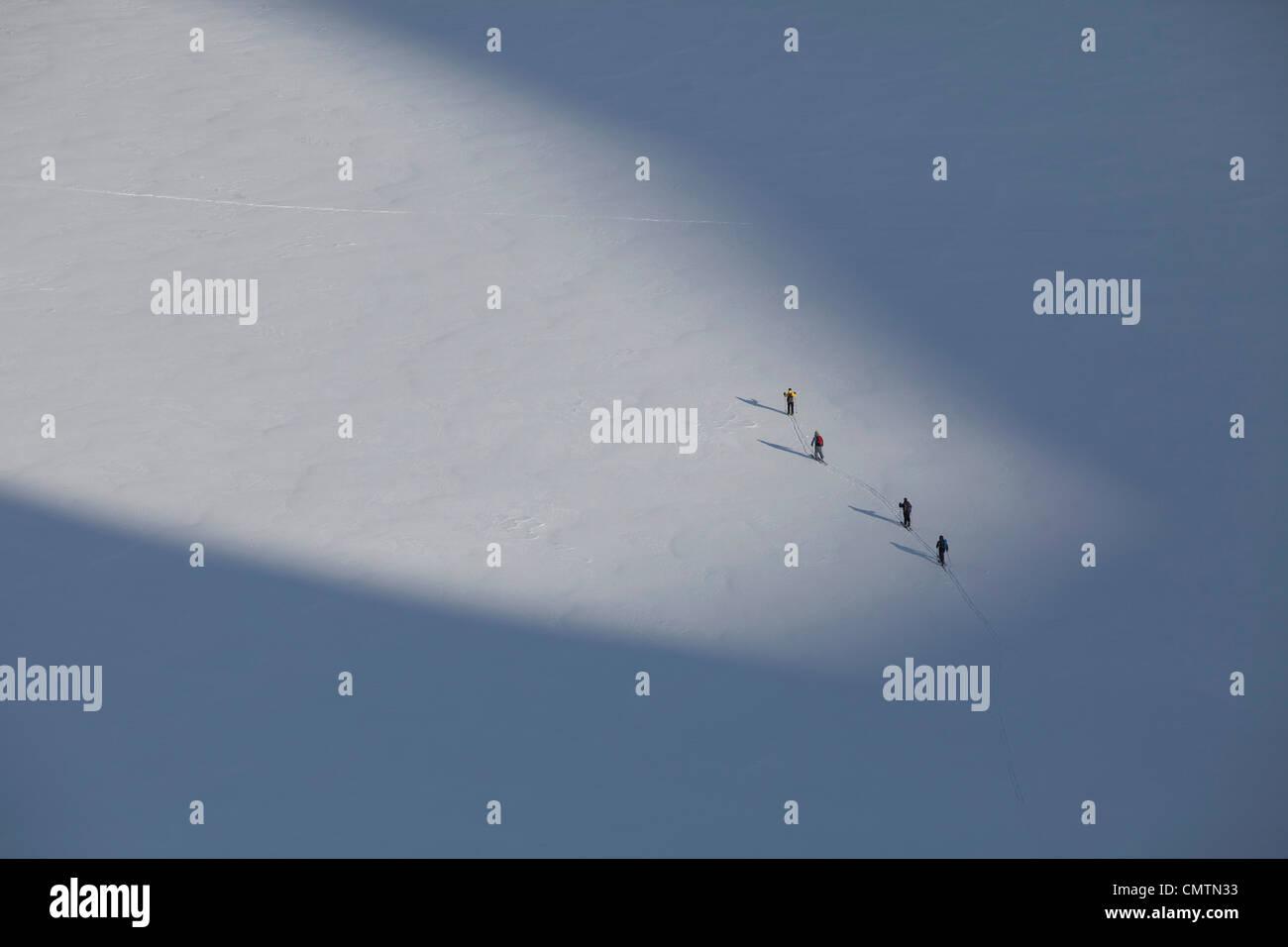Four people on ski tour - Stock Image
