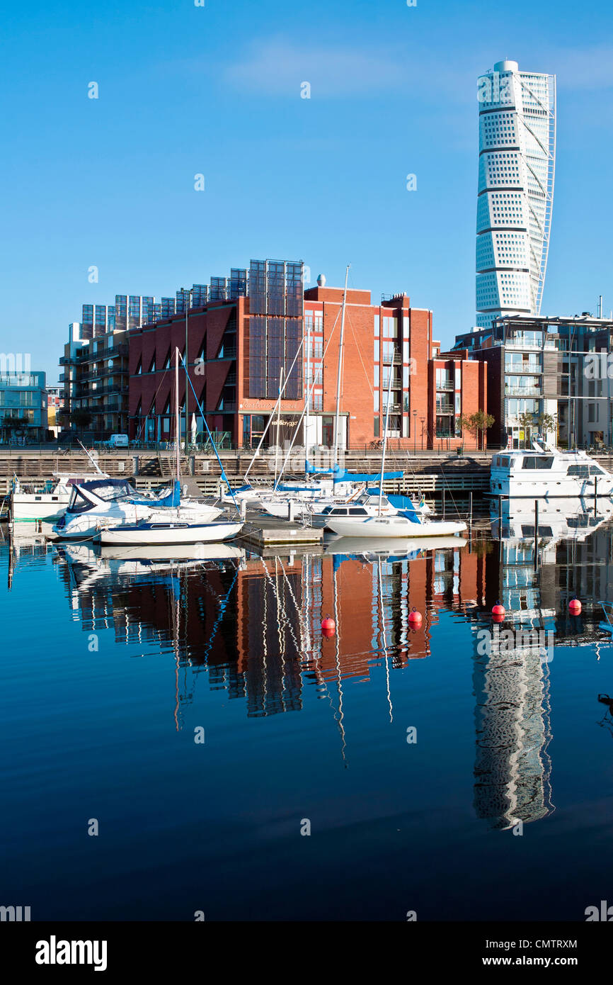 Moored boats and buildings against clear sky - Stock Image