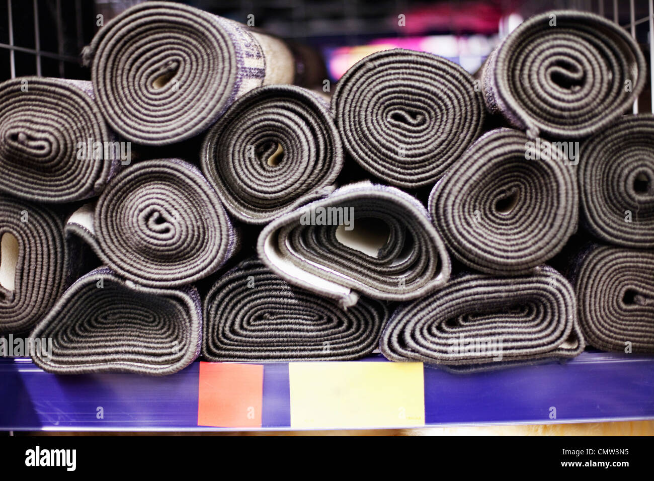 Close-up of rolled carpets for sales - Stock Image