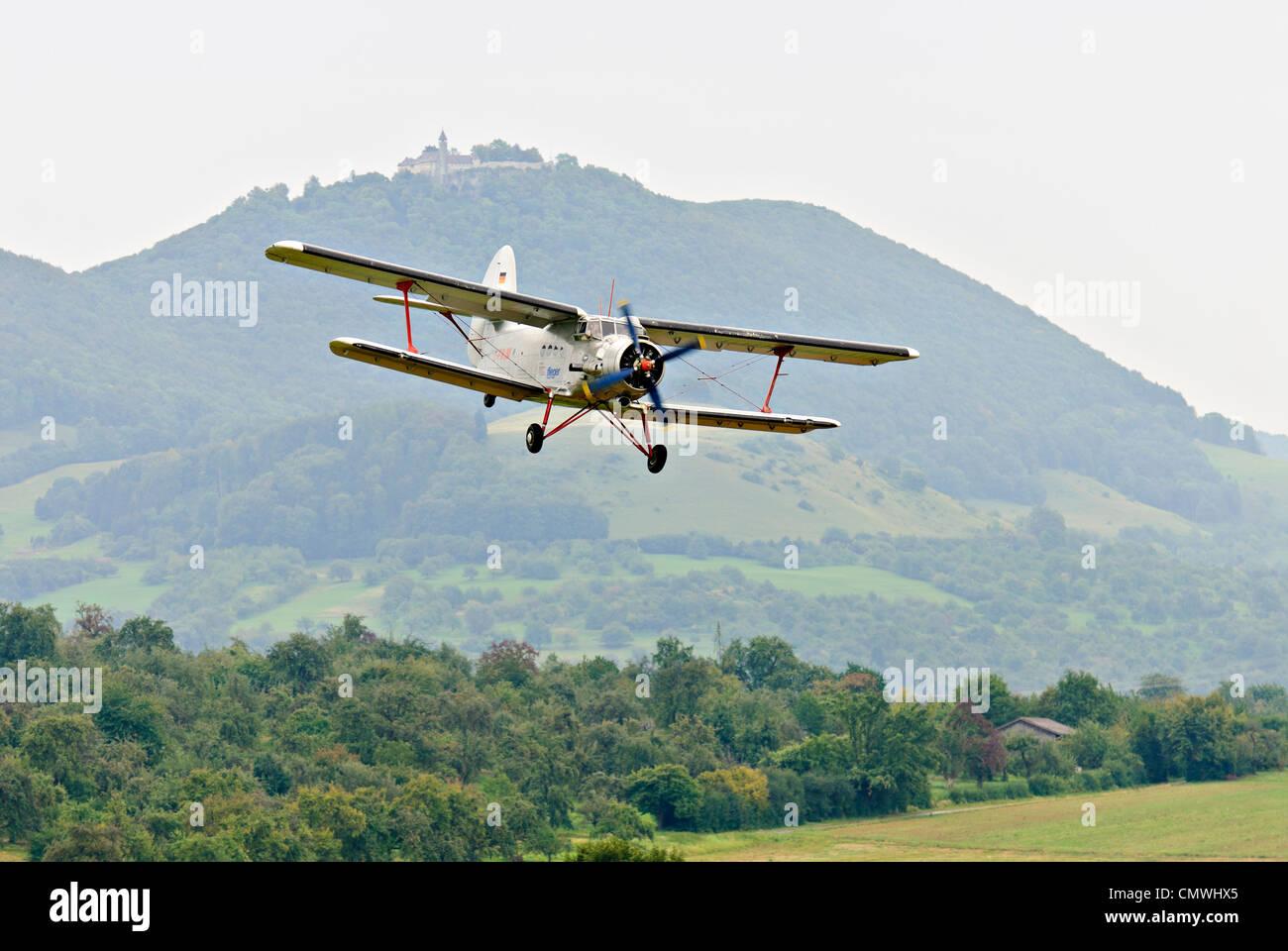 """1975"" Antonov An-2 landing approach at the Hahnweide vintage air show, Kirchheim-Teck, Germany - Stock Image"