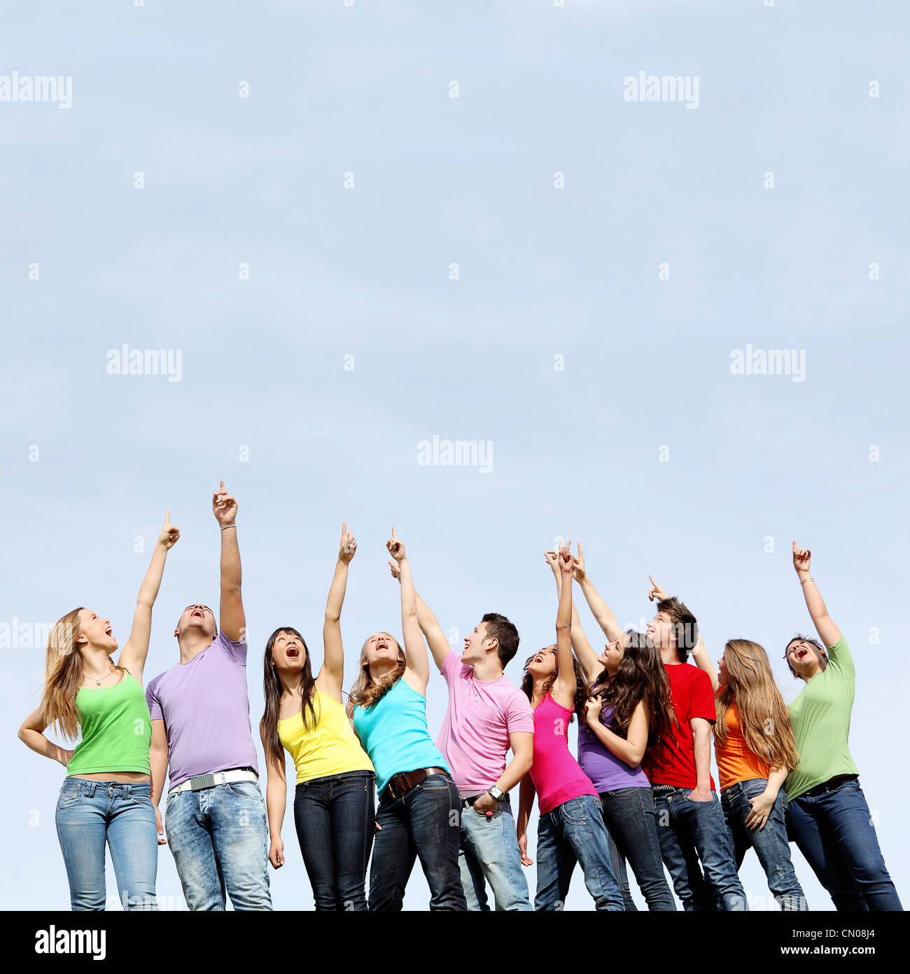 Group of teens pointing - Stock Image