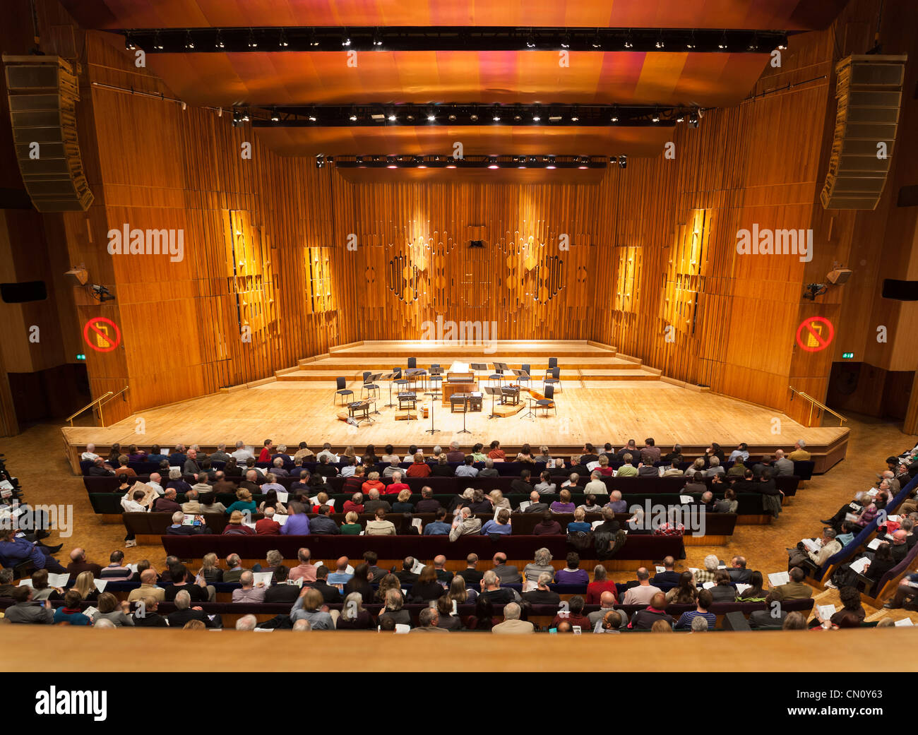 Empty music stage of the Barbican Centre Concert Hall Theatre Theater Auditorium London. With audience public visitors Stock Photo