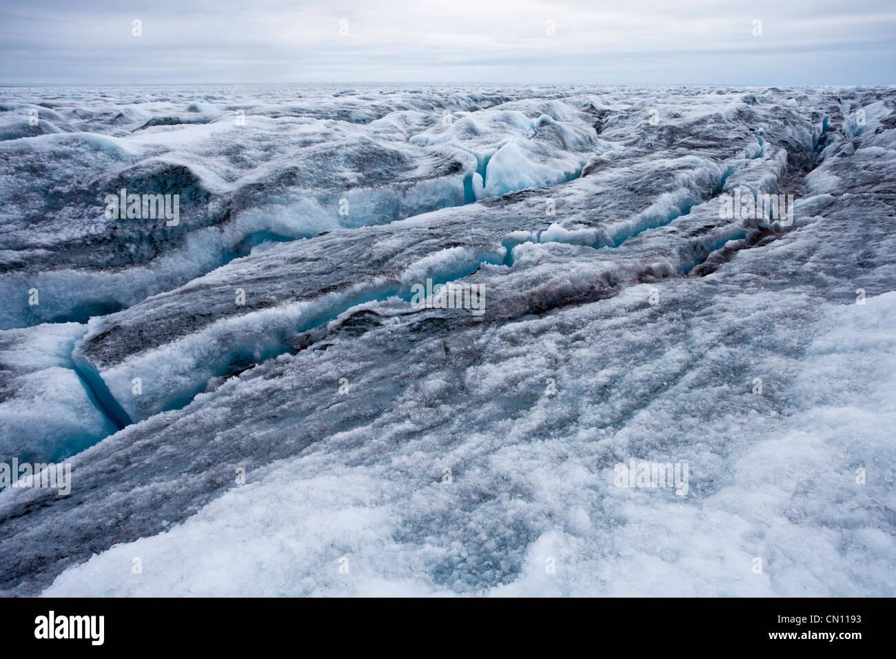 Crevassed glacier icecap arctic landscape in Greenland - Stock Image