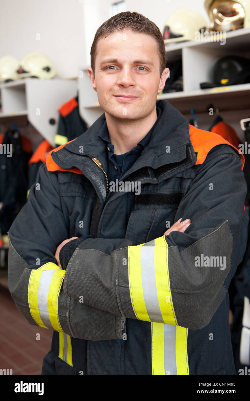 Picture from a young and successful firefighter at work - Stock Image
