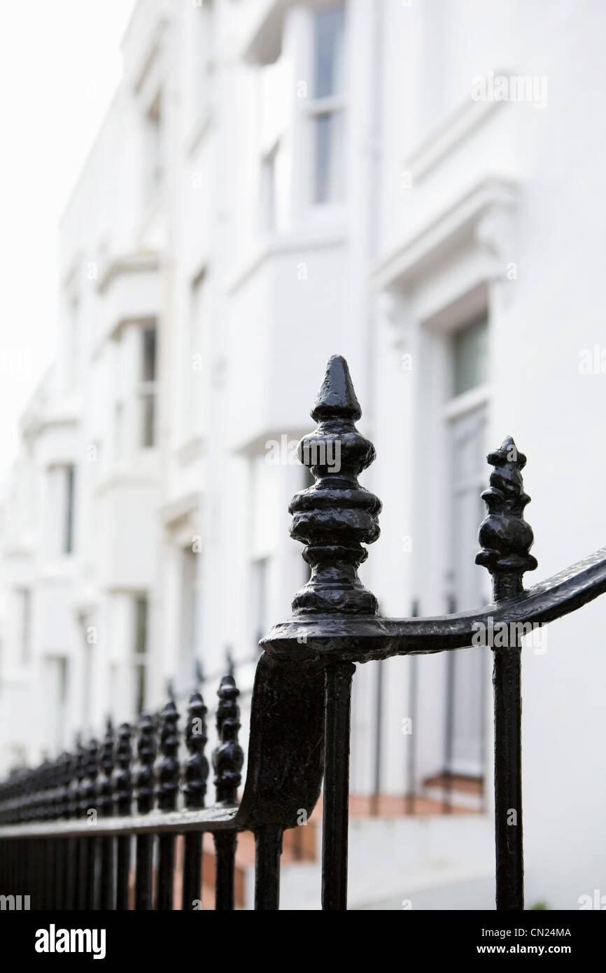 Railings outside terraced houses - Stock Image