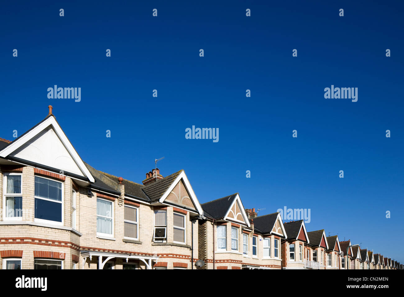 Street of houses and blue sky - Stock Image