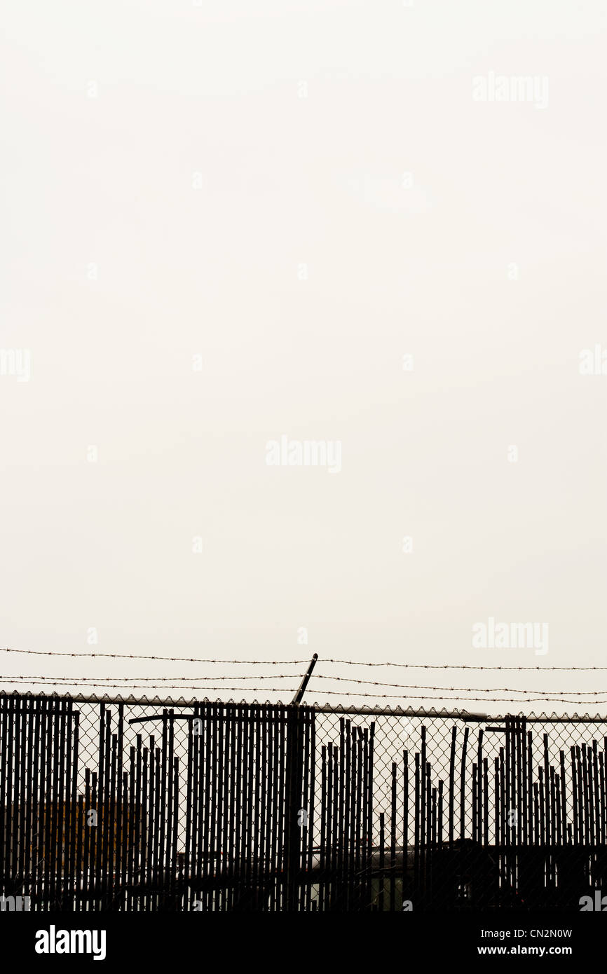 Barbed wire fence and skyline, New York City, New York, USA - Stock Image