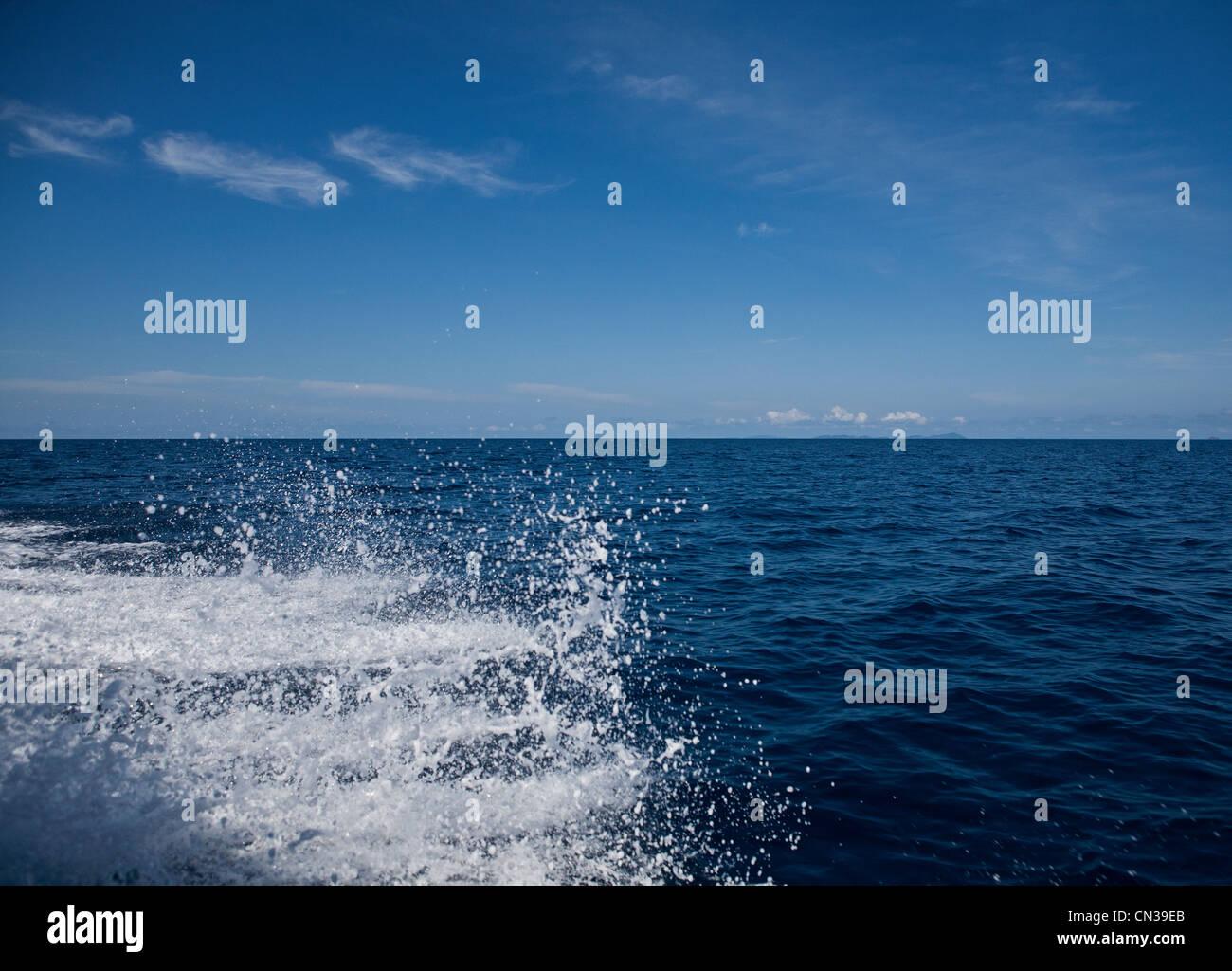 Sea spray from speedboat on South China Sea near Tioman Island, Malaysia - Stock Image
