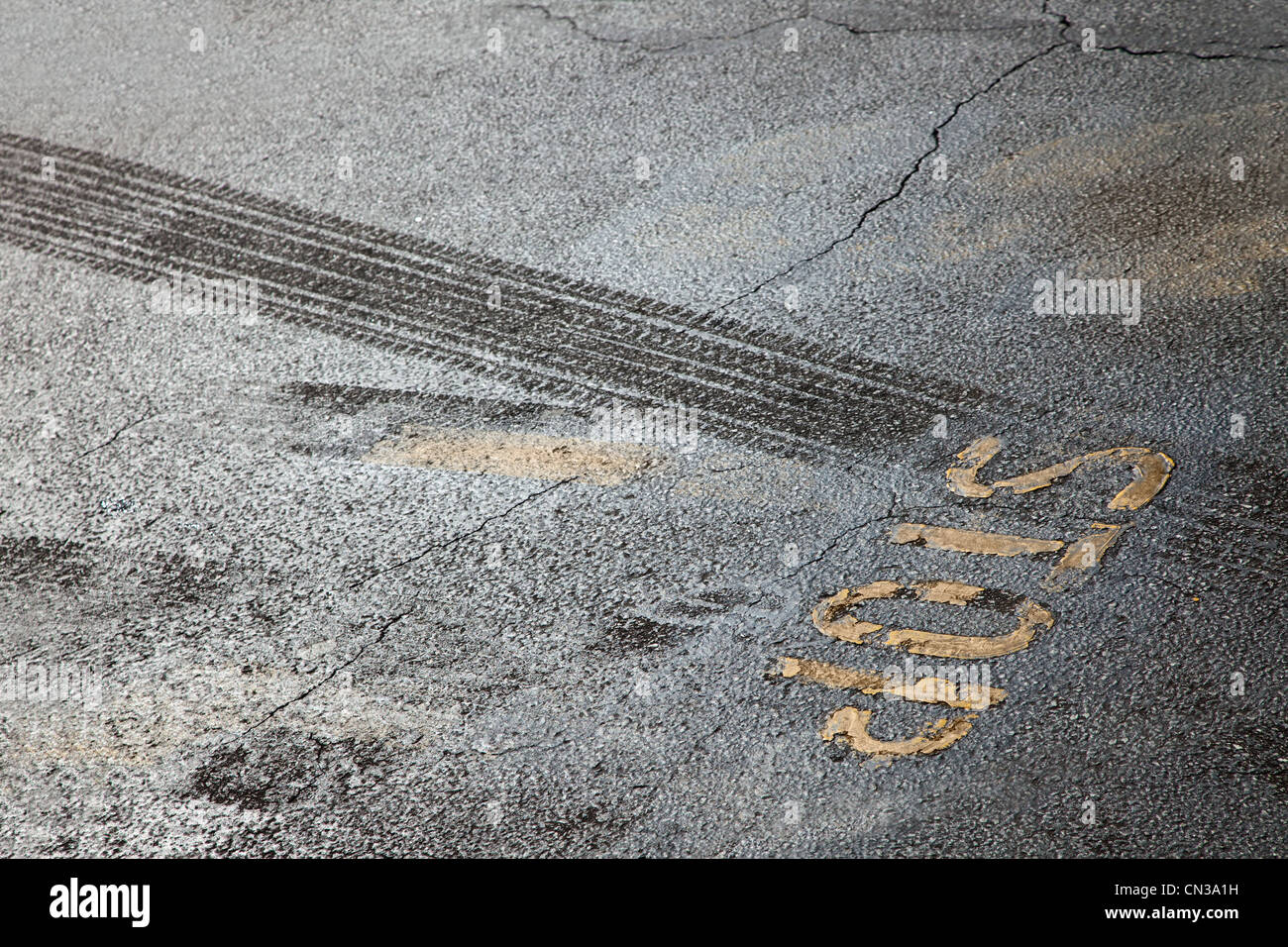 Tire tracks and stop sign - Stock Image