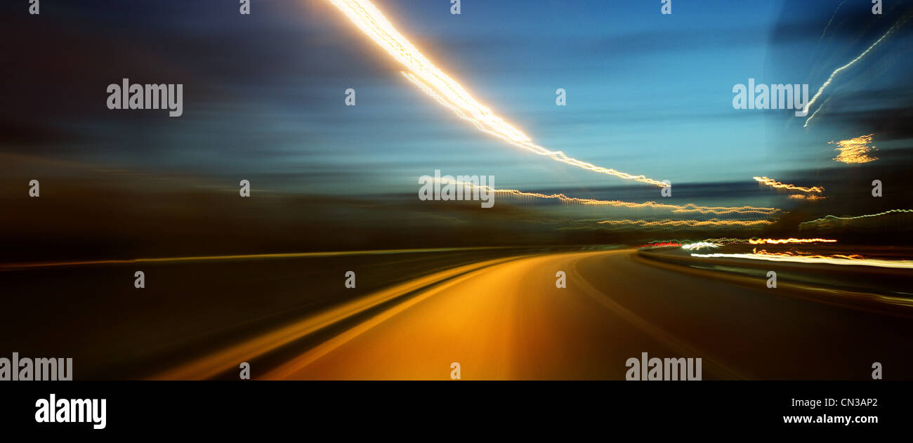Road at night, blurred motion - Stock Image