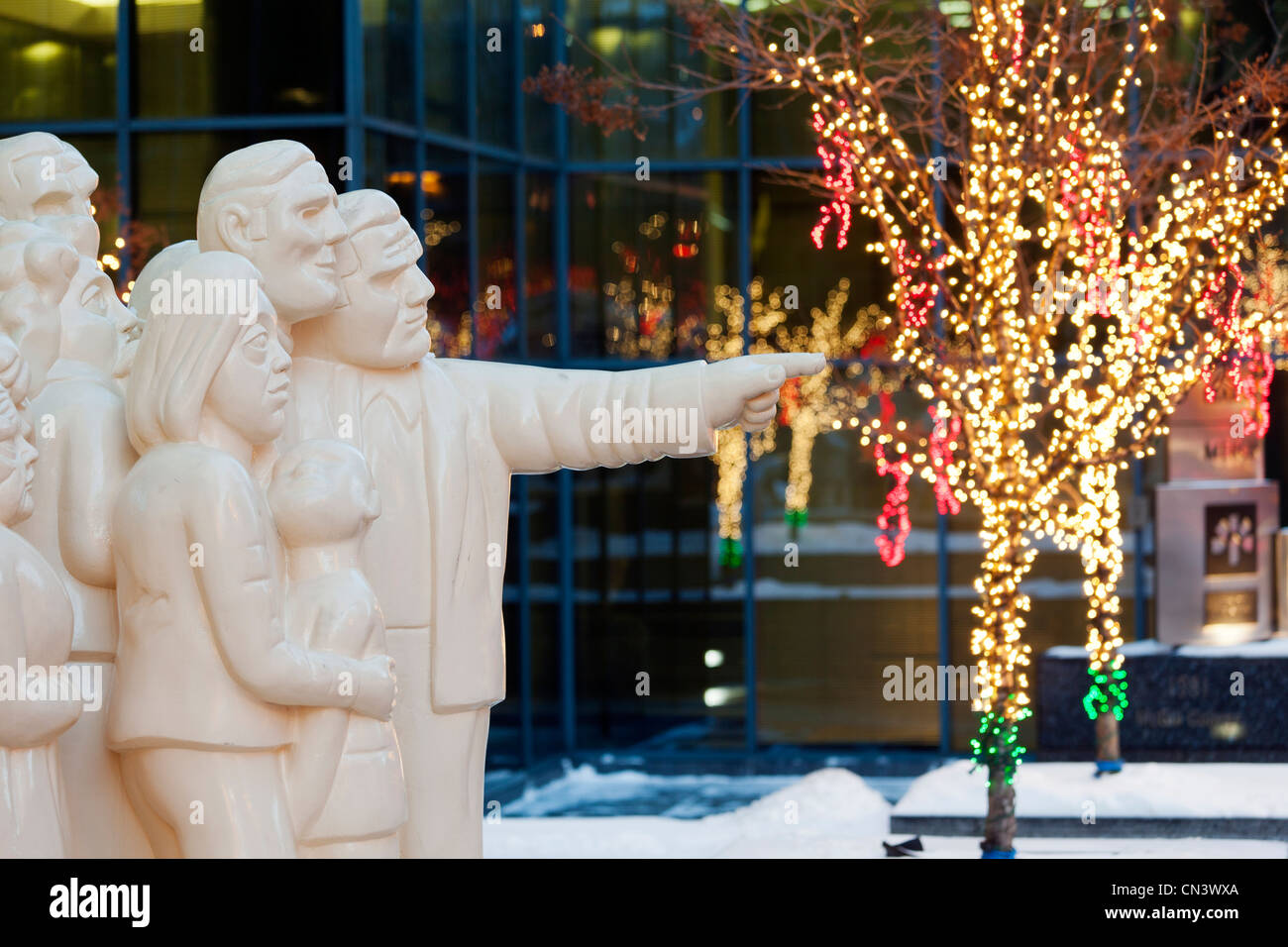 canada quebec province montreal decorations and christmas lights avenue mcgill college sculpture la foule illumine by