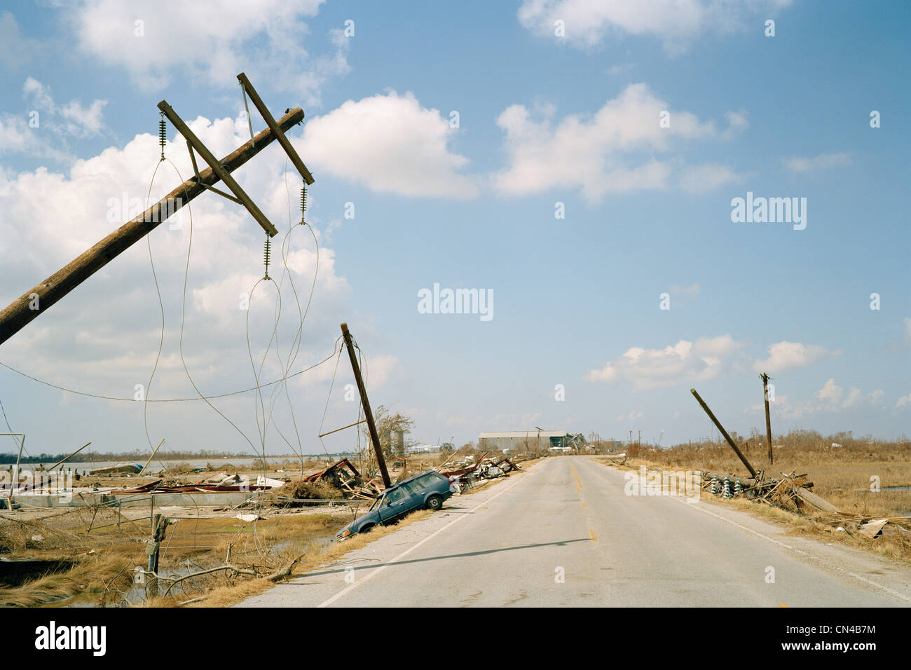Fallen telephone poles and crashed car, aftermath of Hurricane Katrina, Cameron, Louisiana. USA - Stock Image