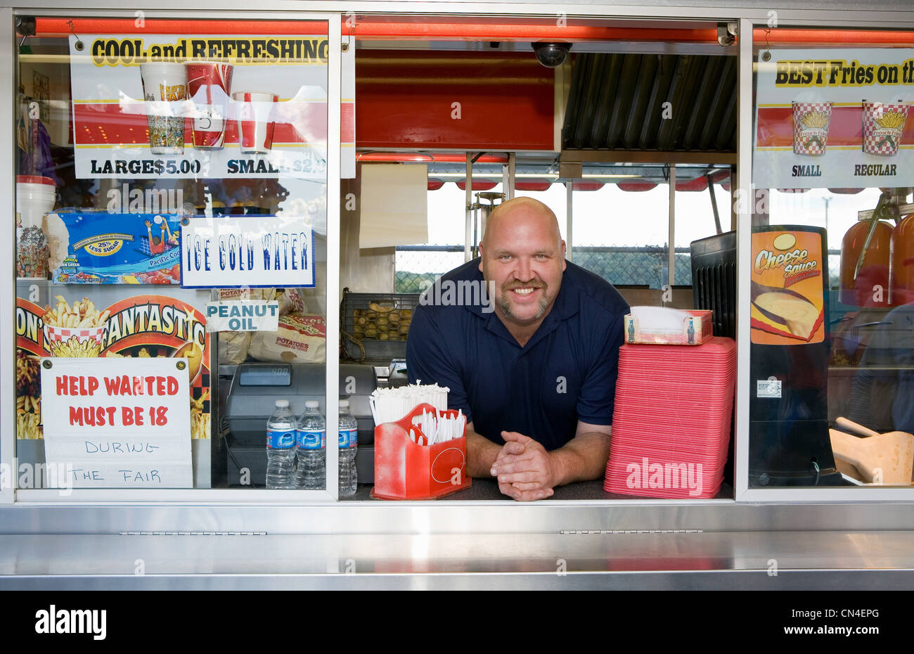 Owner of food stall at county fayre, smiling - Stock Image