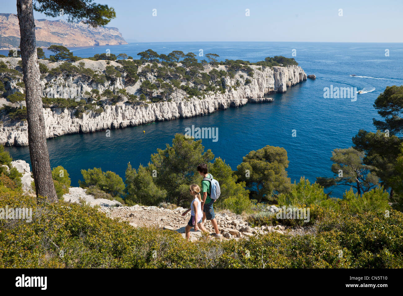 France, Bouches du Rhone, Cassis, the creek (Calanque) of Port Pin, children hiking - Stock Image