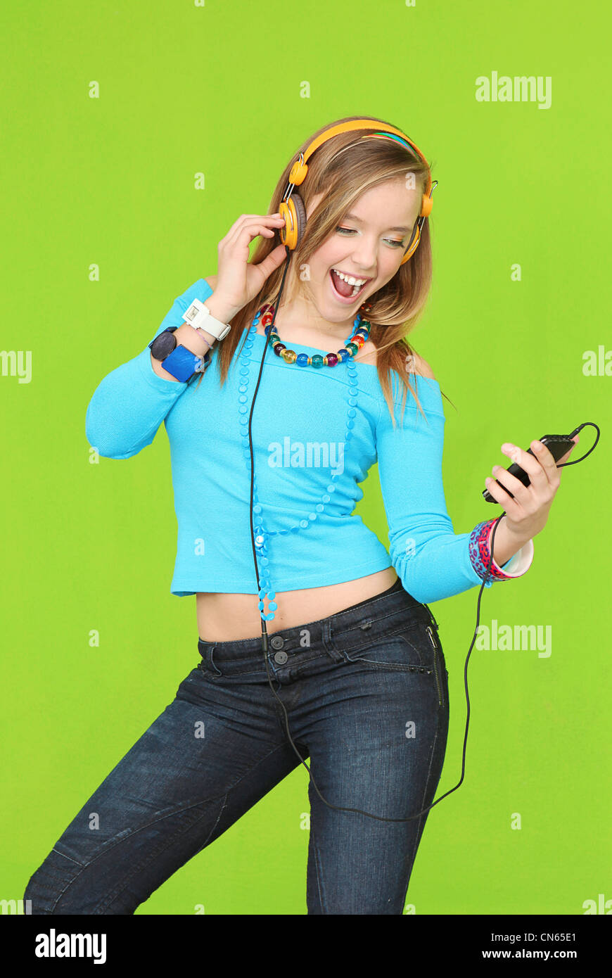 teen with headphones listening to music - Stock Image