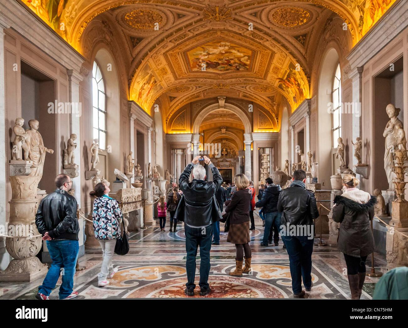 Tourists in the Vatican Museum, Rome, Italy - the Gallery of Statues in the Museo Pio-Clementino - Stock Image