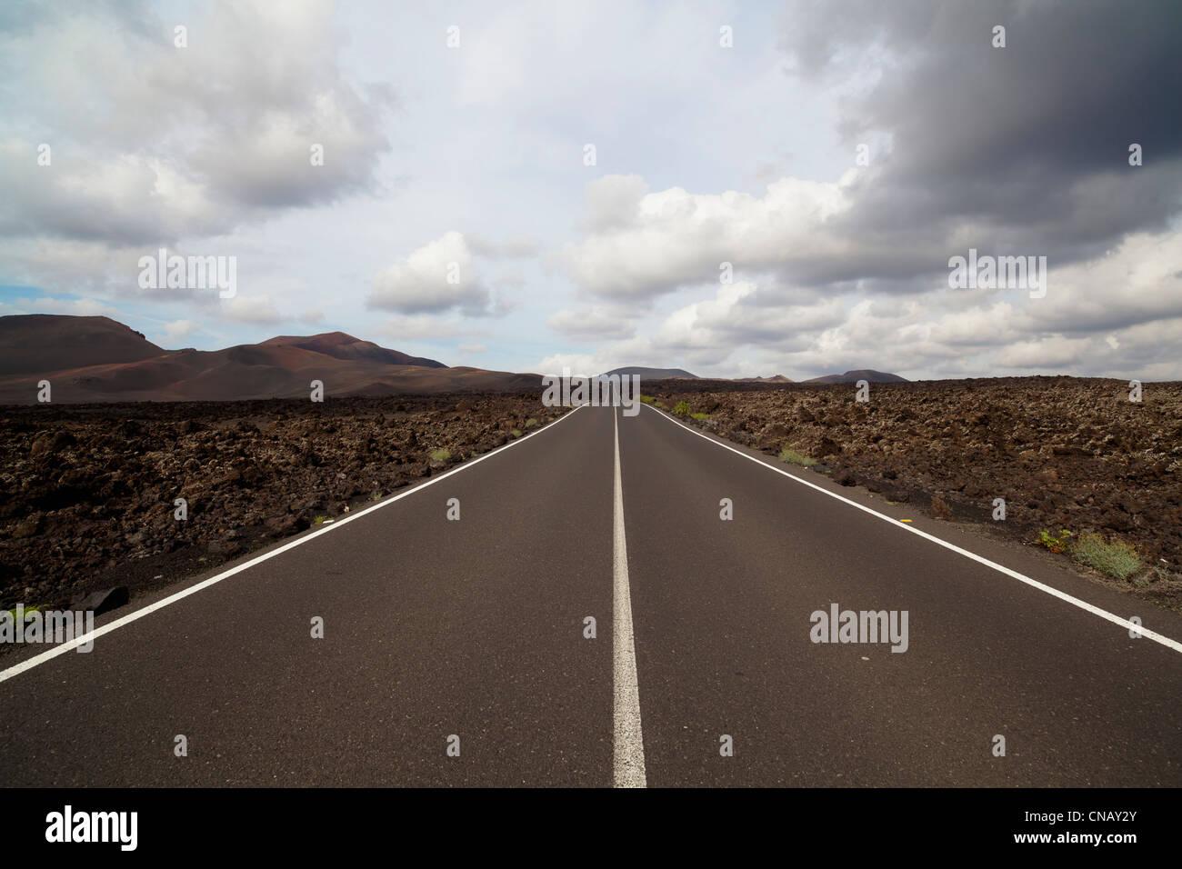 Paved road in rural landscape - Stock Image