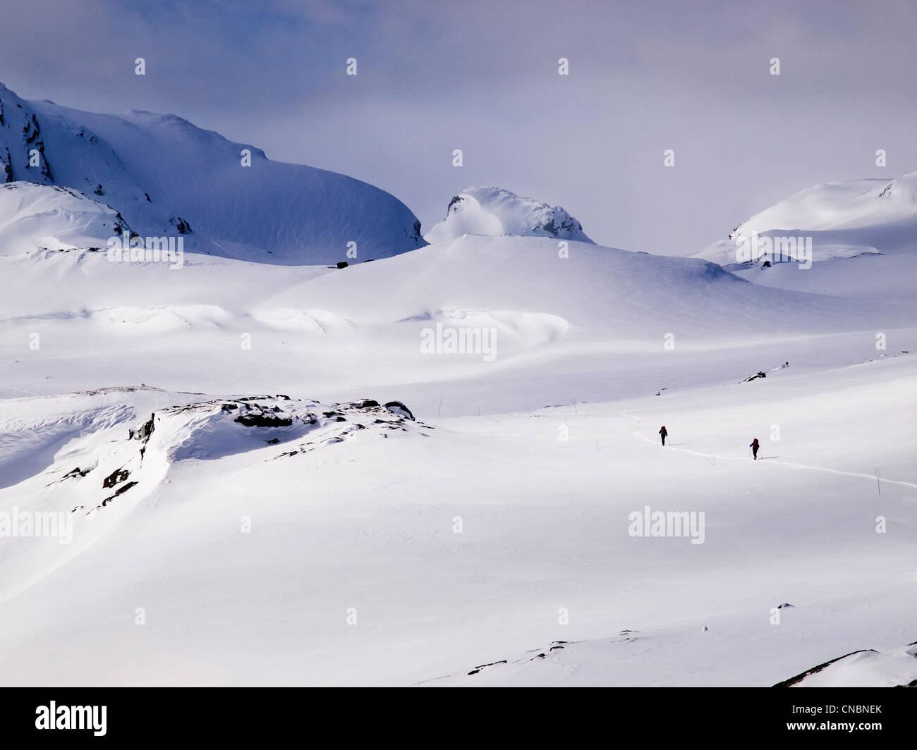 2 people ski touring in the Hardanger region of Norway - Stock Image