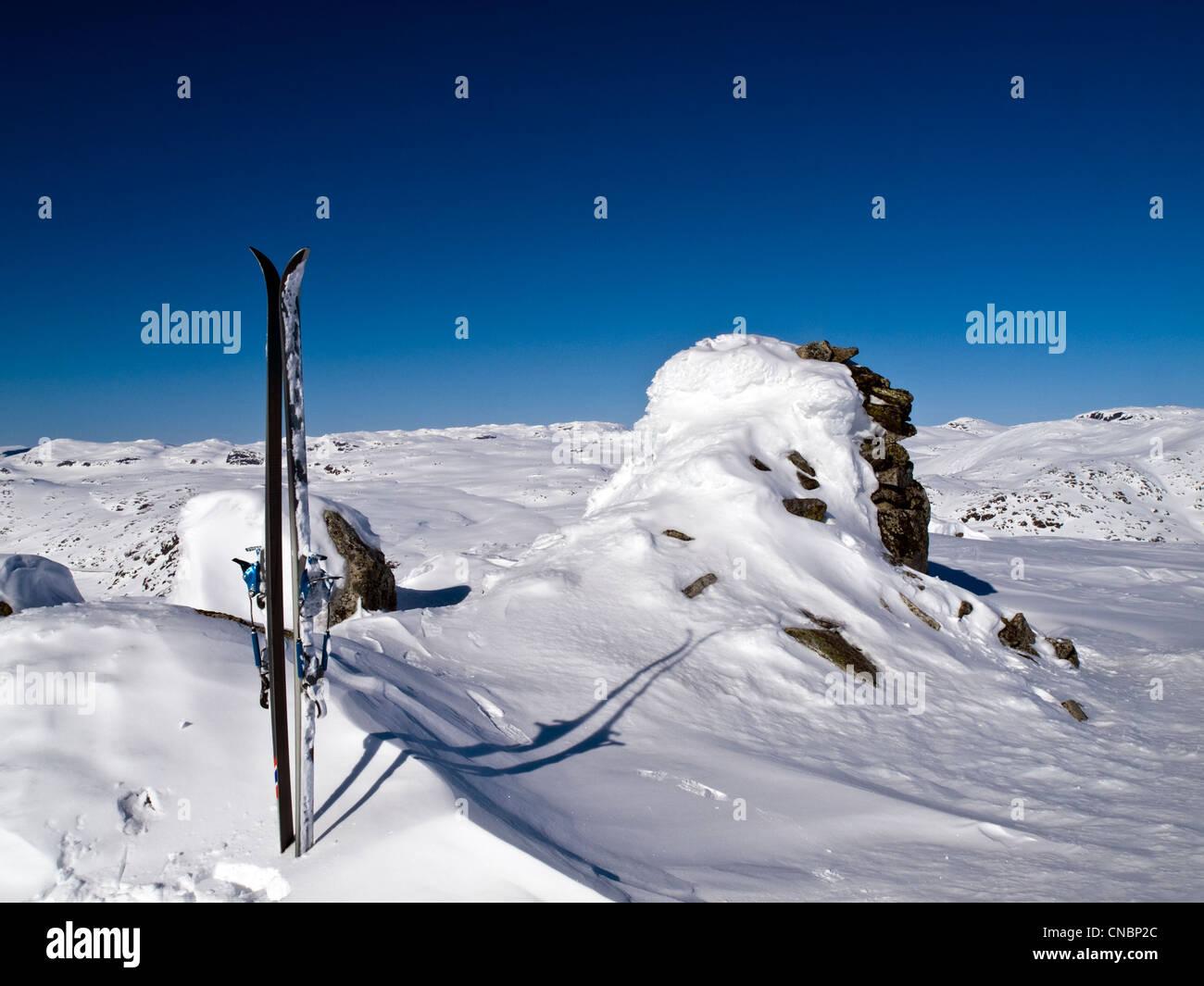 Pair of skis on summit. ski mountaineering in the Hardanger region of Norway - Stock Image