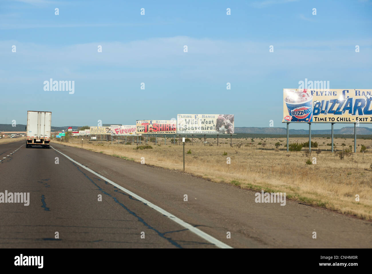 Large billboards on the side of an open highway - Stock Image