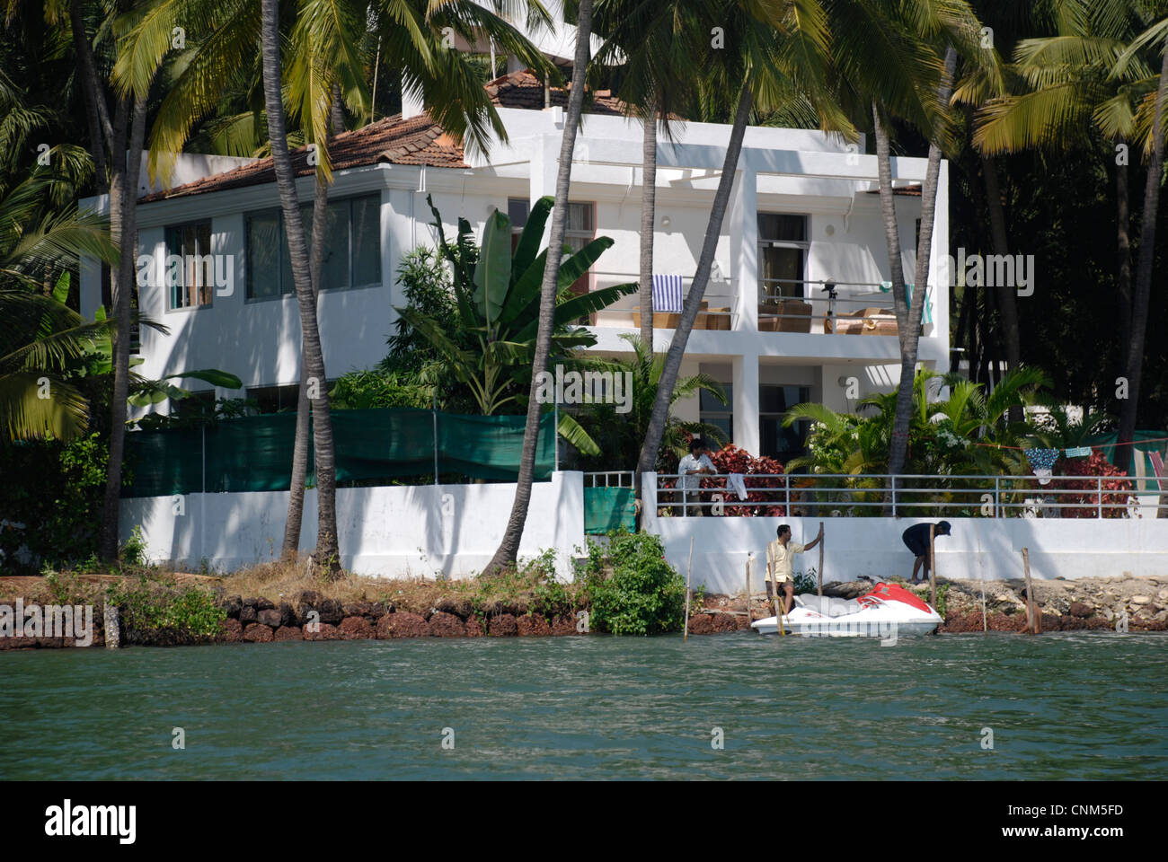 A wealthy riverside home in Goa, India - Stock Image
