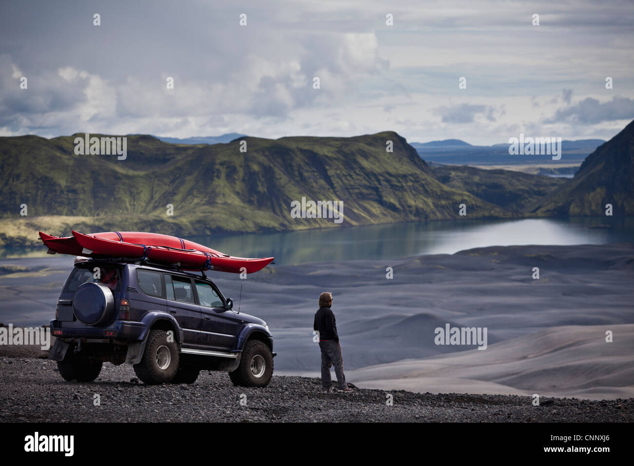 Man with Jeep admiring rural landscape - Stock Image
