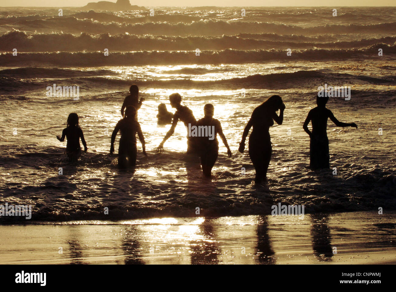 sri-lanka-sunset-children-playing-in-the-waves-at-sunset-bentota-beach-CNPWMJ.jpg