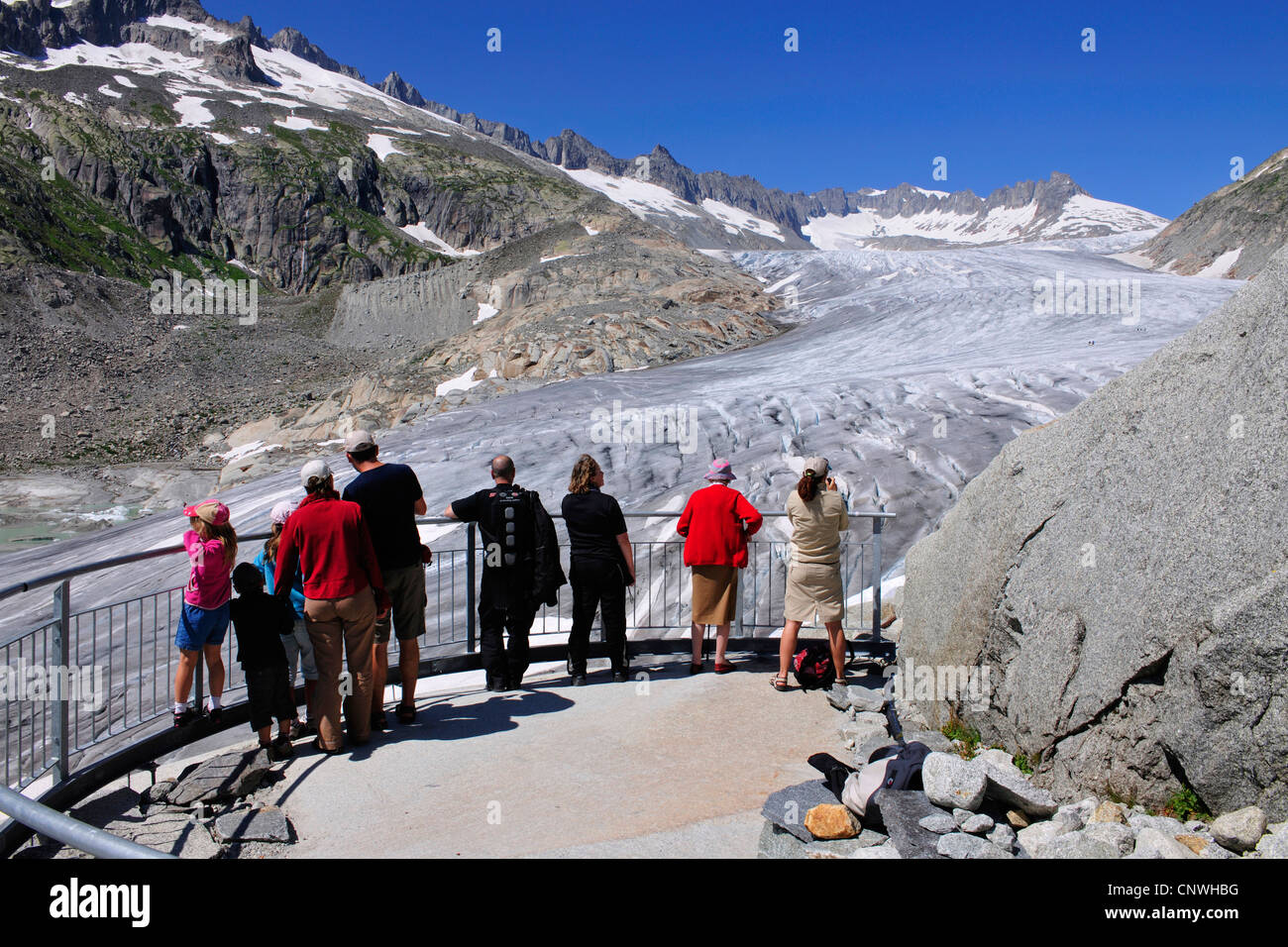 view from viewing platform with visitors at the Rhne Glacier, Switzerland, Valais - Stock Image