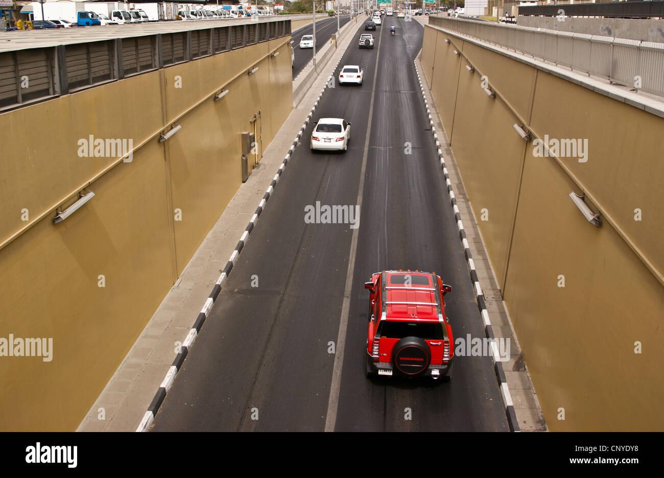 a-red-suv-on-al-shindagha-road-tunnel-under-dubai-creek-united-arab-CNYDY8.jpg
