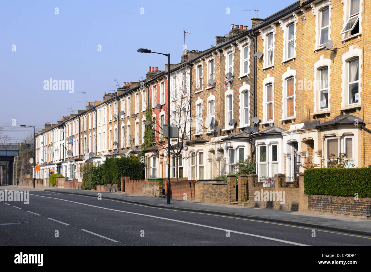 Long row of old three storey terraced flats & apartments without parked cars in Hackney London close to town centre Stock Photo