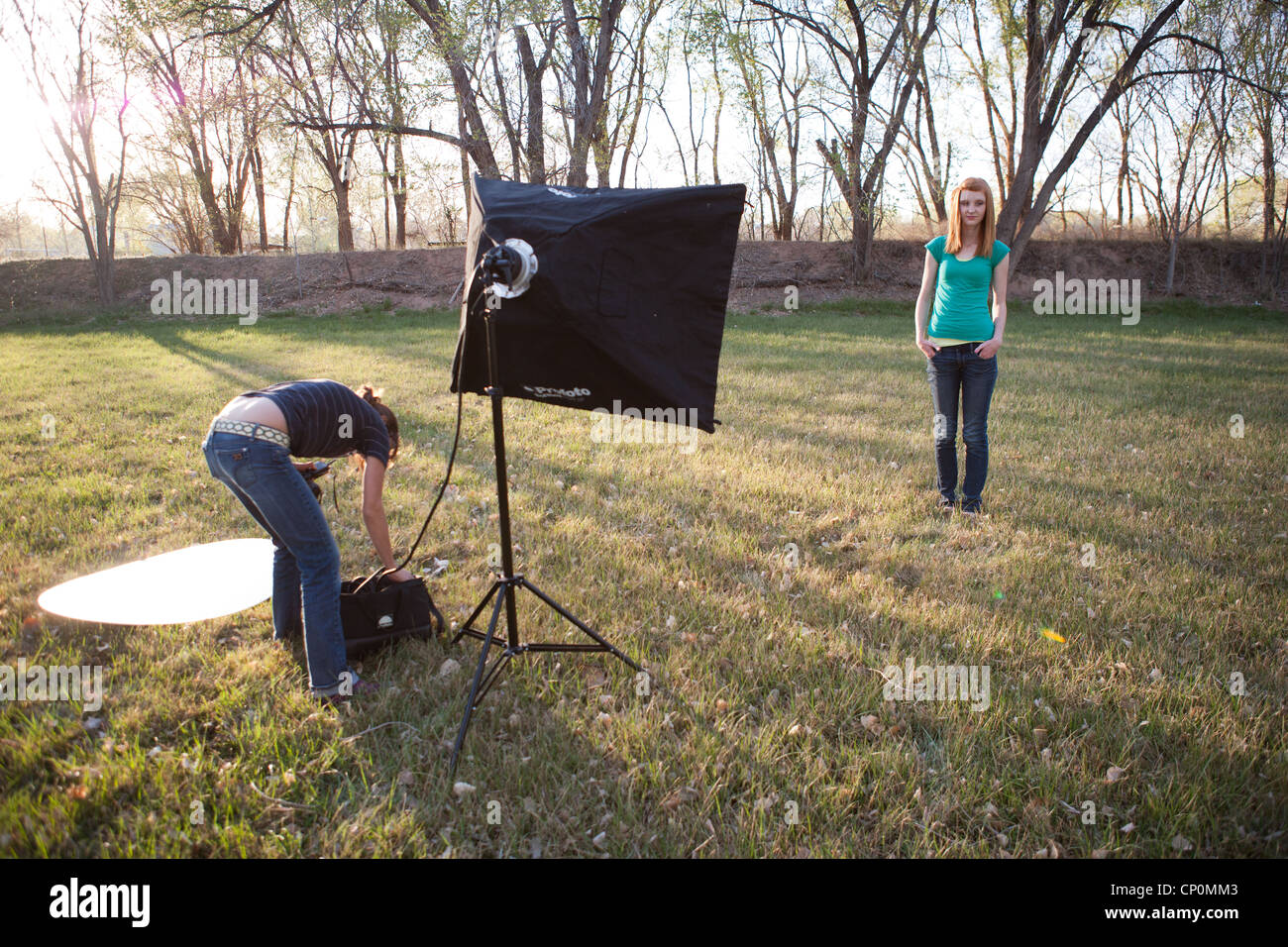 Photo shoot outdoors with teen model in a rural area. - Stock Image