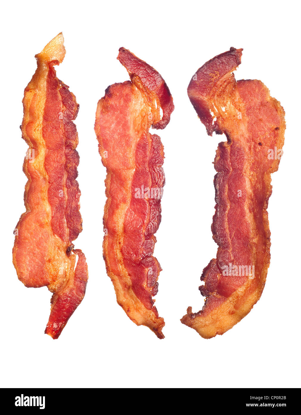 Three cooked, crispy fried bacon isolated on a white background. Good for many health and cooking inferences. - Stock Image