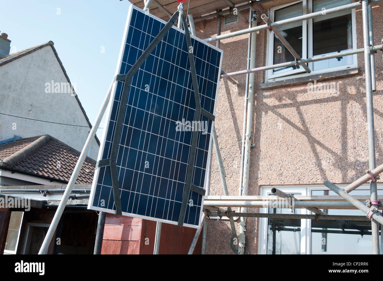 solar-panel-being-lifted-to-roof-for-ins