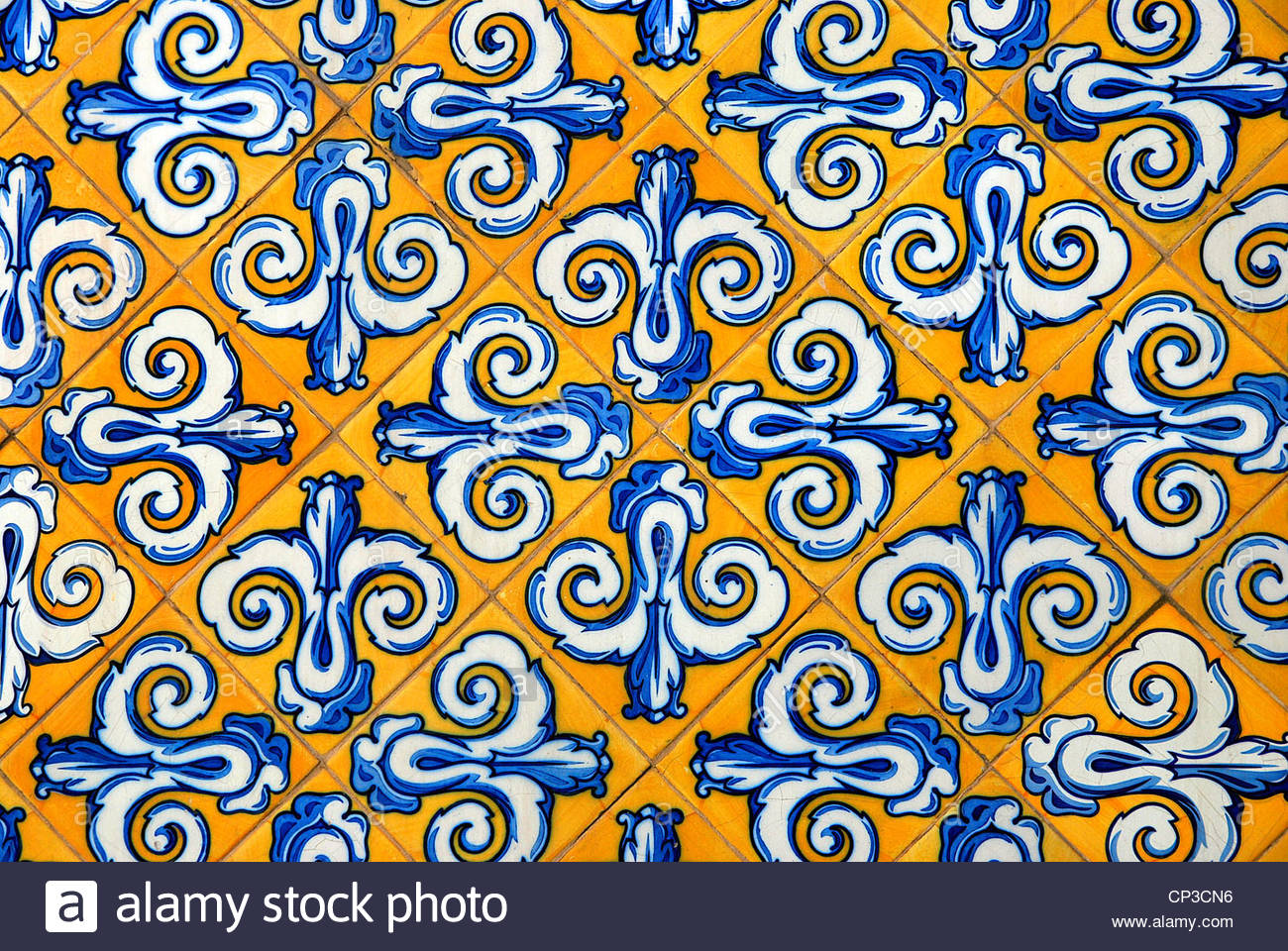 Traditional spanish ceramic tiles in yellow and blue stock photo traditional spanish ceramic tiles in yellow and blue dailygadgetfo Choice Image