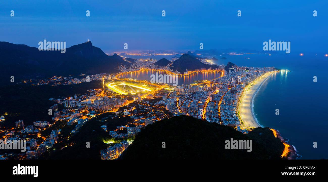 Rio de Janeiro south zone at night Ipanema and Leblon beaches  statue of Christ the Redeemer Lagoa Rodrigo de Freitas - Stock Image