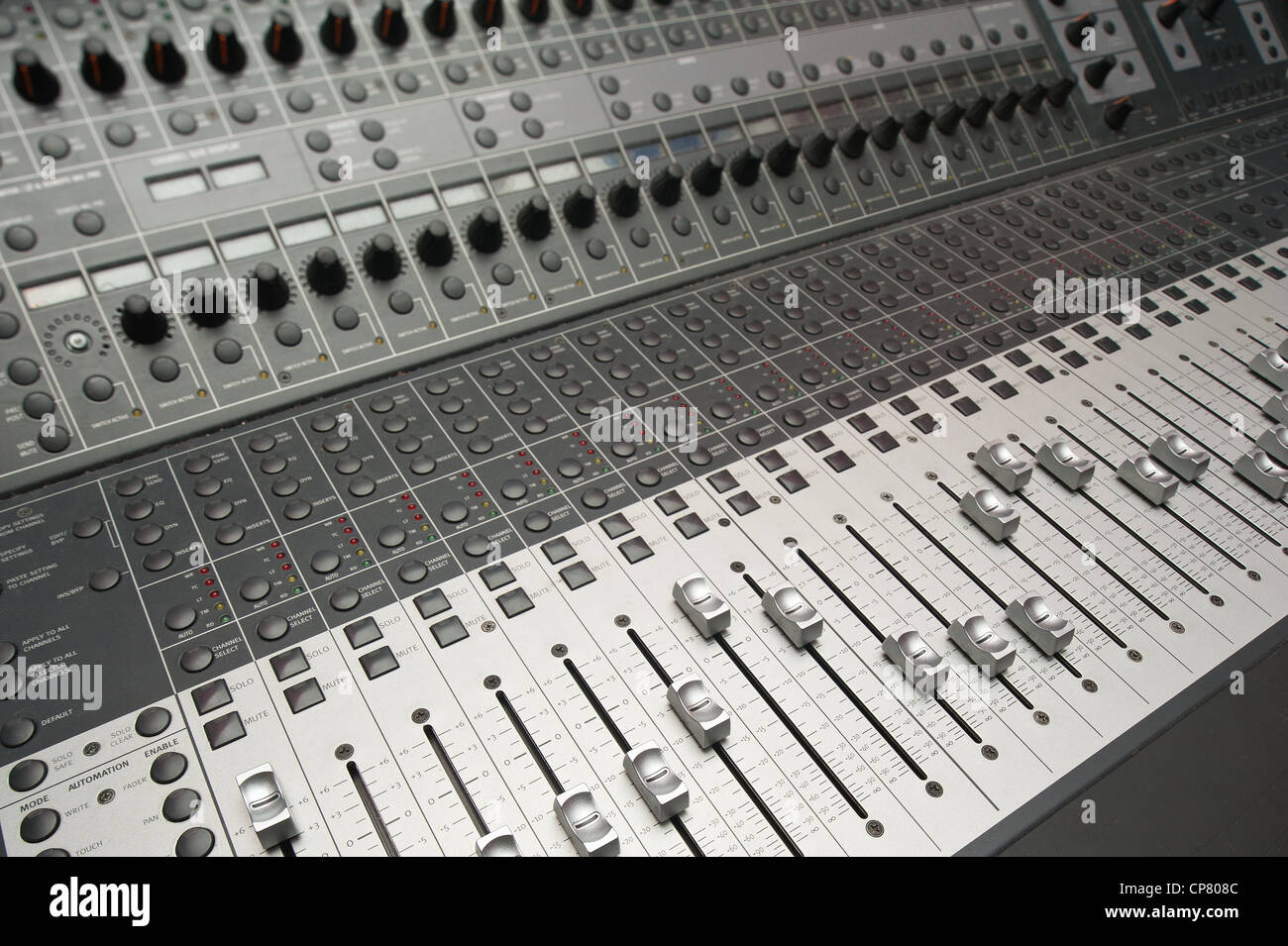 electronic sound audio mixing desk console in recording studio stock