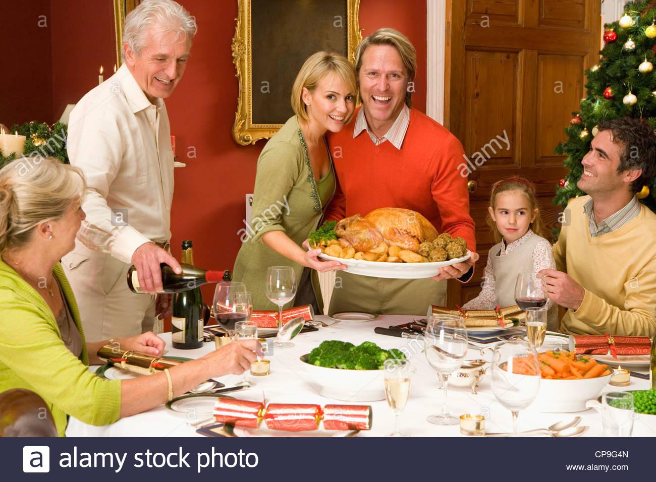 Family having Christmas dinner, portrait of couple with turkeyStock Photo