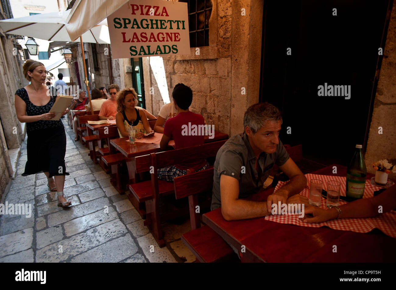 Outdoor Dining In A Italian Restaurant In A Narrow Street Old Town