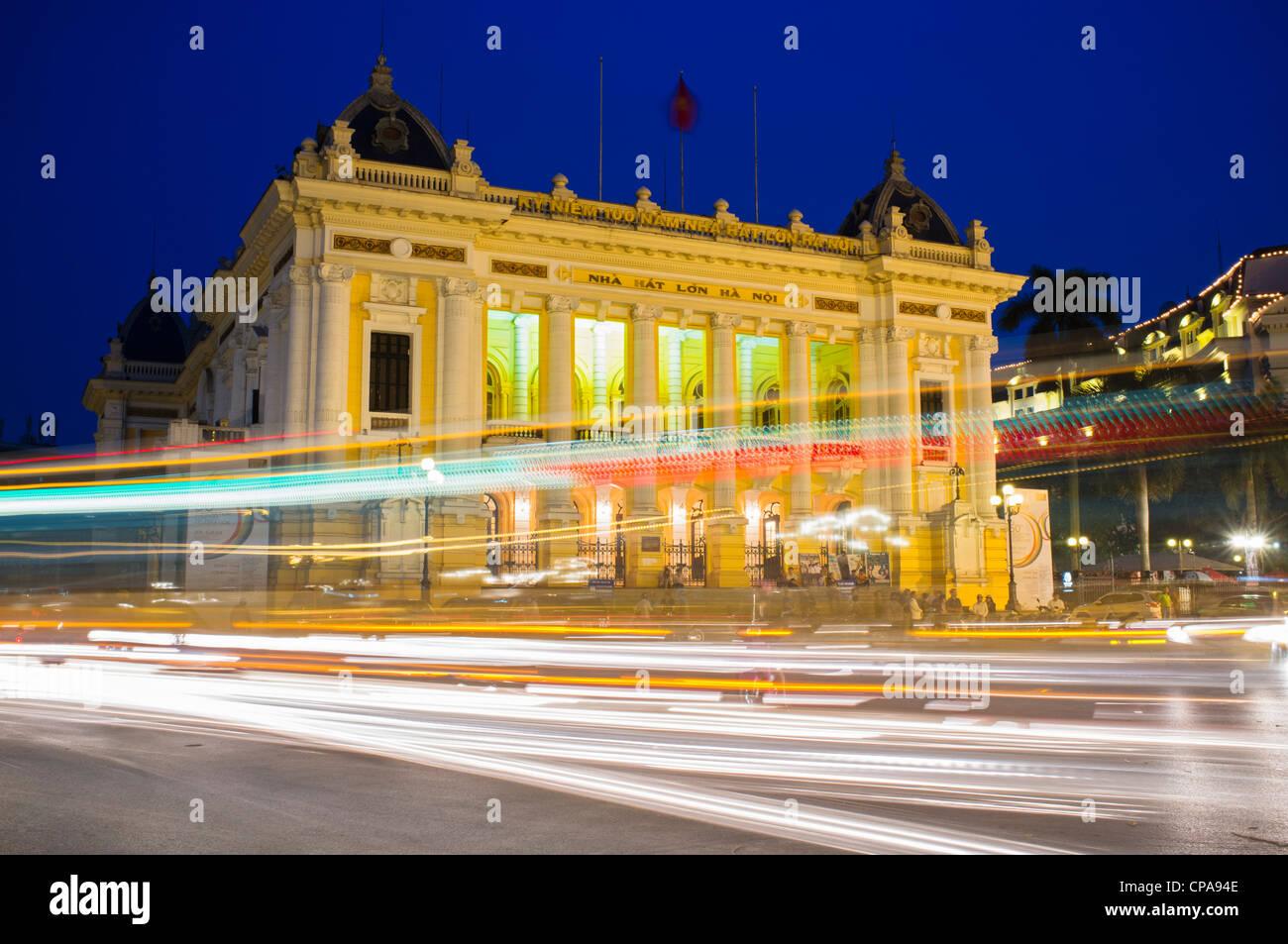 Night view of Hanoi Opera House with traffic Vietnam - Stock Image