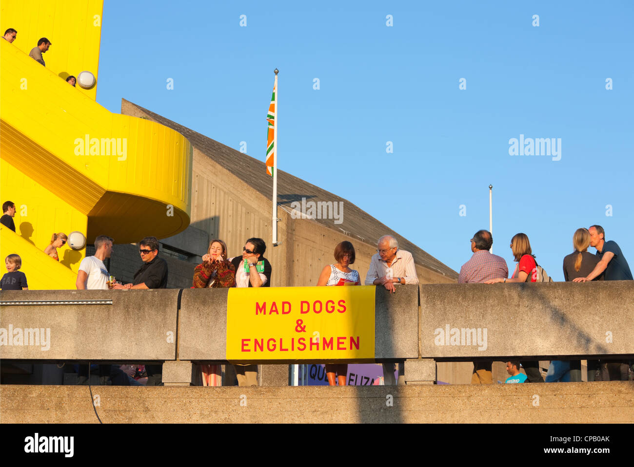 People leaning over balcony of BFI; London; England - Stock Image