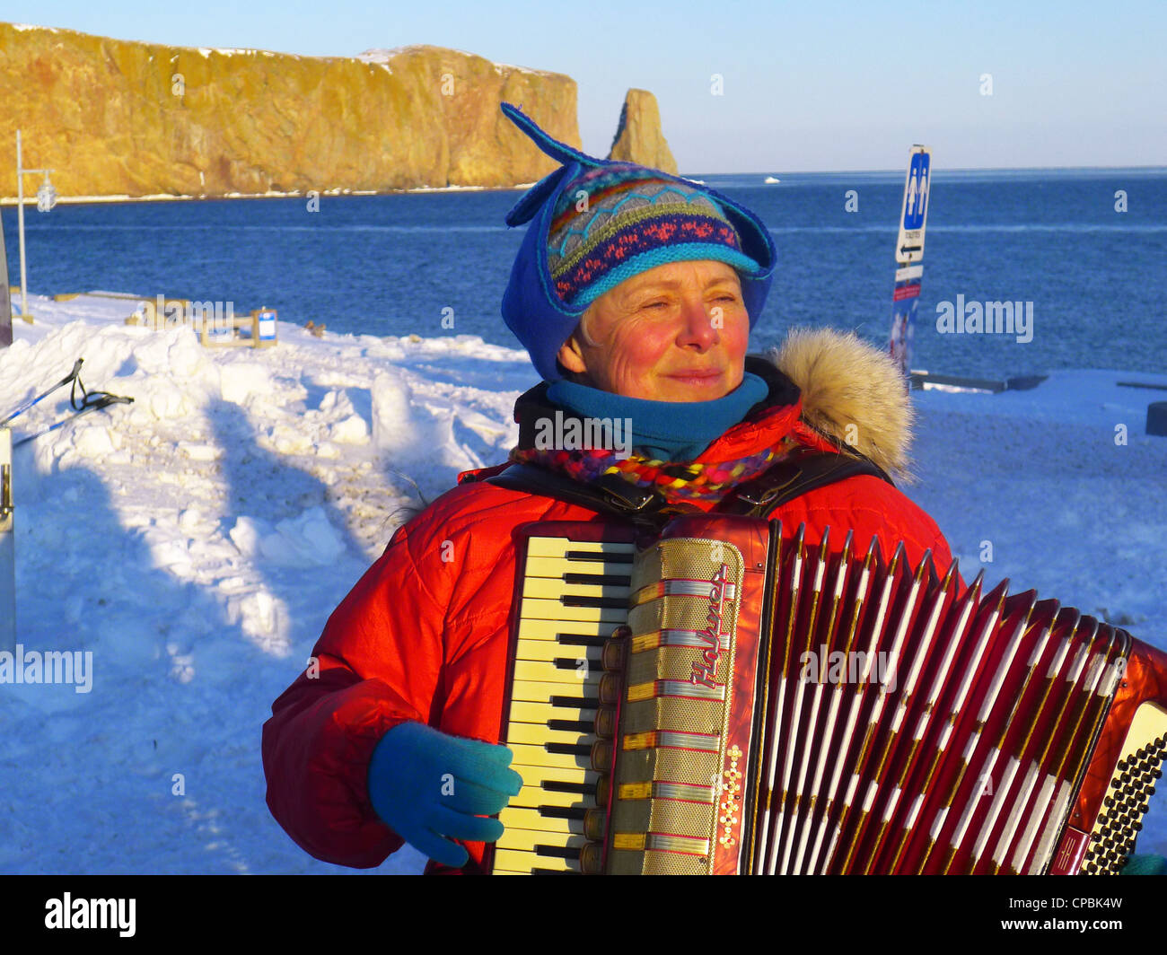 a-lady-playing-the-accordion-outside-in-