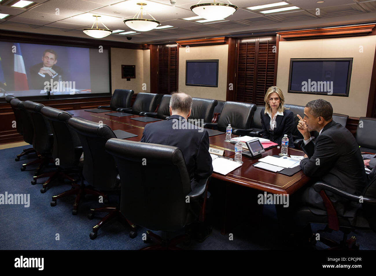 President Barack Obama participates in a video teleconference with President Nicolas Sarkozy of France in the Situation Stock Photo